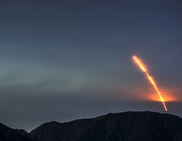 The Atlas V rocket carrying the Mars InSight lander launches from Vandenberg Air Force Base, as seen from the San Gabriel Mountains more than 100 miles away, on Saturday morning. The InSight probe is the first NASA lander designed entirely to study the deep interior structure of Mars. (David McNew/Getty Images)