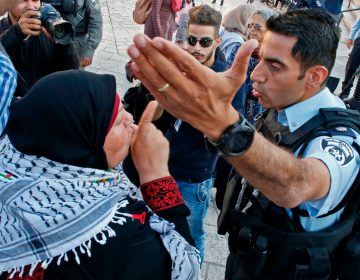 A Palestinian woman argues with a member of the Israeli security forces as they disperse a demonstration outside the Damascus Gate in the old city of Jerusalem on Tuesday. (Hazem Bader/AFP/Getty Images)