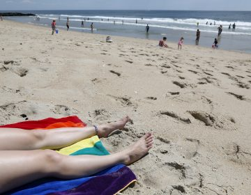 A woman suntans on the beach in Asbury Park, N.J., Wednesday, June 21, 2017. (AP Photo/Seth Wenig)