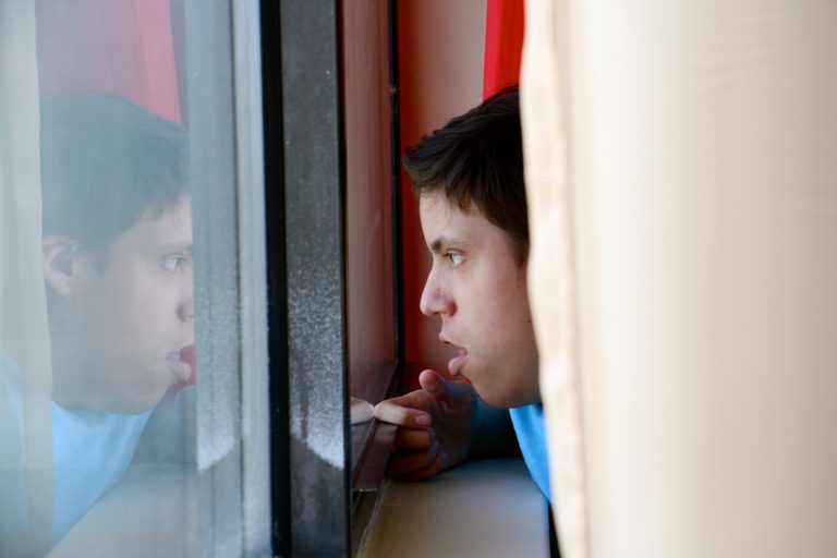Luis Angel Chaparro Crespo, 16, watches the trains go by from the window of his apartment on the sixth floor of the Harrison Homes in North Philadelphia.