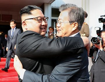 North Korean leader Kim Jong Un (left) and South Korean President Moon Jae-in embrace Saturday on the North Korean side of the shared inter-Korean area of Panmunjom. (Handout/South Korean Presidential Blue House/Getty Images)