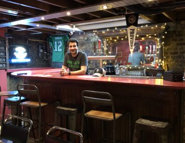 Owner JP Teti stands behind the basement bar at Passyunk Avenue, a Philly-themed dive bar in London