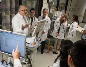 Dr. Paul Marik (left) discusses patient care with medical students and resident physicians during morning rounds at Sentara Norfolk General Hospital in 2014 in Norfolk, Va. (Jay Westcott for The Washington Post/Getty Images)