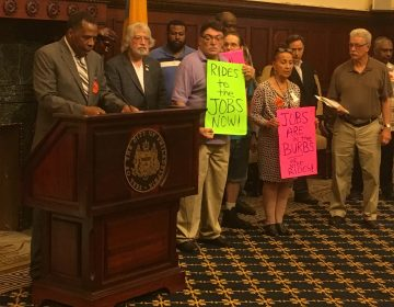 Philadelphia Unemployment Project board members and supporters rally in the mayor's reception room for more reverse commuter vanpool funds