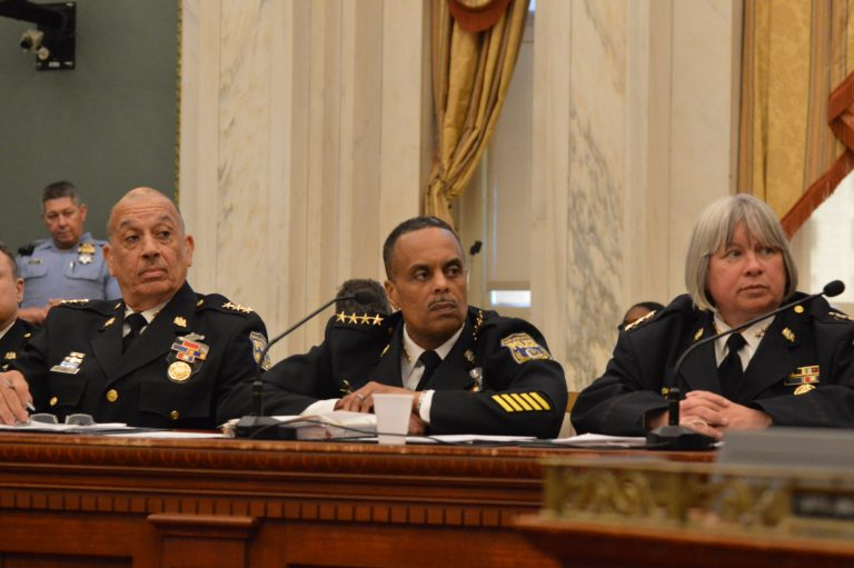 Philadelphia Police Commissioner Richard Ross (center) and deputies at City Council hearing (Tom MacDonald/WHYY)