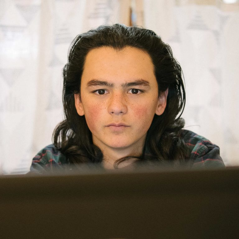 Sam Oozevaseuk Schimmel, 18, has grown up in both Alaska and Washington state. He is an advocate for Native Alaskan youth. (Kiliii Yuyan for NPR)