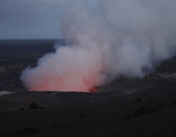 Steam and gas rise from Kilauea's summit crater in Volcanoes National Park, Hawaii. Wednesday, May 9, 2018. Geologists warned Wednesday that Hawaii's Kilauea volcano could erupt explosively and send boulders, rocks and ash into the air around its summit in the coming weeks. (AP Photo/Jae C. Hong)