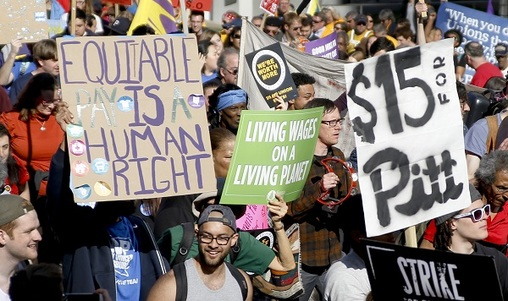 In this April 14, 2016, file photo, union organizers, students, and supporters for a $15 an hour wage march through the Oakland section of Pittsburgh. (Keith Srakocic/AP Photo, File)