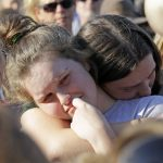 Santa Fe High School sophomore Averi Gary (center) is comforted during a vigil after the deadly mass shooting in Texas on Friday. David J. Phillip/AP