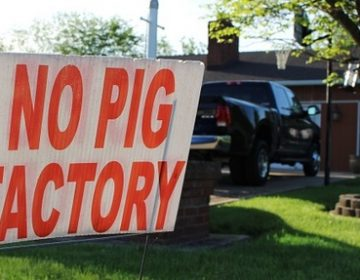 In this May 21, 2018 photo, a sign opposing an industrial hog farm is displayed at a home in Berwick, Pa. Residents who complain about foul smells from the nearby hog farm have taken their fight to the Pennsylvania Supreme Court. (Michael Rubinkam/AP Photo)