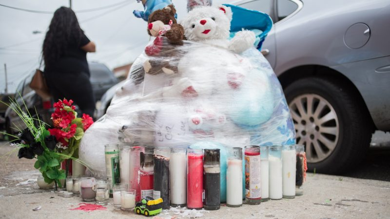 A memorial for 17-year-old Sandrea Williams sits at the corner where whe was shot and killed in outside of her mother's West Philadelphia home. (Emily Cohen for WHYY)