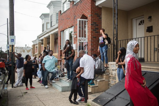 Community members gather to rally to bring justice for the death of Sandrea WIlliams three weeks after she was shot to death and two other teenage boys were shot outside of her mother's home in West Philadelphia on May 11th, 2018. (Emily Cohen for WHYY)
