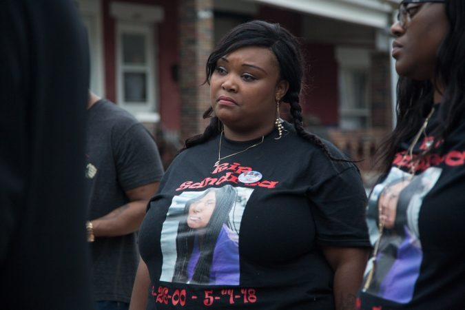 Nadia Syblis the mother of Sandrea Williams, stands solemnly as other speak at a rally to bring justice to her and her family for the death of her 17 year old daughter three weeks after she was gunned down in a random act of violence outside of her West Philadelphia home on May 11th 2018. (Emily Cohen for WHYY)