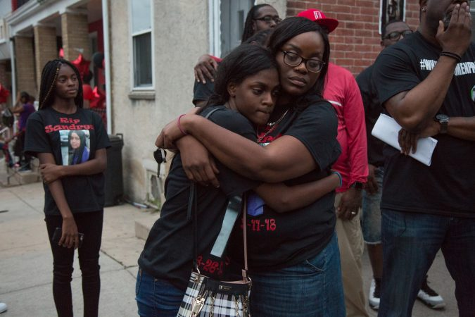 Family members of Sandrea Williams find comfort in each other at a memorial for the 17 year old who was shot in front of her mother's home on May 11th 2018, along with two other boys. Her family, friends, and community rallied together on May 31st, 2018 in an effort to bring justice for Sandrea. (Emily Cohen for WHYY)