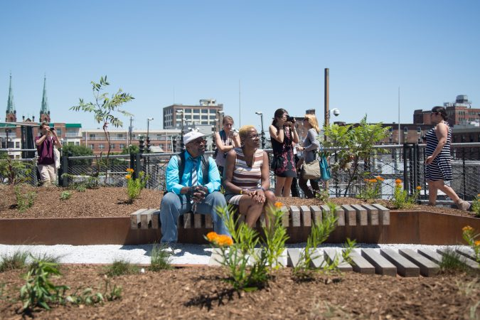 Benches and greenery populate the new park giving Philadelphians and visitors a new place to view the city from. (Emily Cohen for WHYY)
