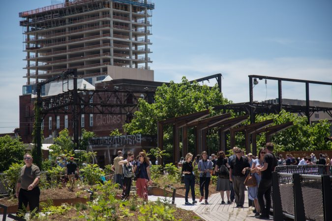 Philadelphians of all ages gather to inaugurate the first quarter mile of the Philadelphia Rail Park June 14th 2018. (Emily Cohen for WHYY)