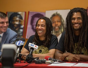 Debbie Africa sits with her lawyer, Brad Thomson (left), and her son Michael Africa Jr (right) as she makes her first public appearance since being released from prison after 39 years and 10 months of incarceration on June 19th 2018. (Emily Cohen for WHYY)