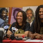 Debbie Africa sits with her lawyer, Brad Thomson (left), and her son Michael Africa Jr. (right) as she makes her first public appearance since being released from prison after 39 years and 10 months of incarceration. (Emily Cohen for WHYY)
