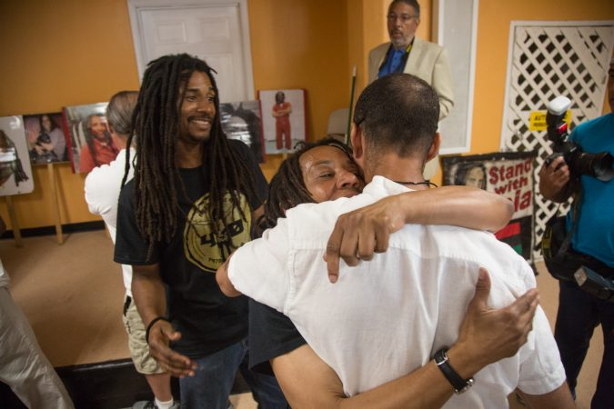 MOVE member Debbie Africa makes her first public appearance since being released from prison after 39 years and 10 months of incarceration. She hugs and greets members of the community who have come out to support her. (Emily Cohen for WHYY)