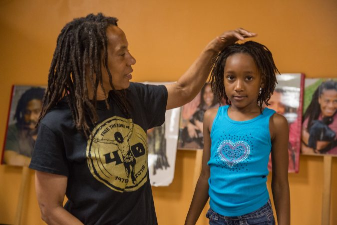 Debbie Africa plays with her granddaughter, Alia, 6, at her first public appearance since being released from prison after 39 years and 10 months of incarceration. (Emily Cohen for WHYY)