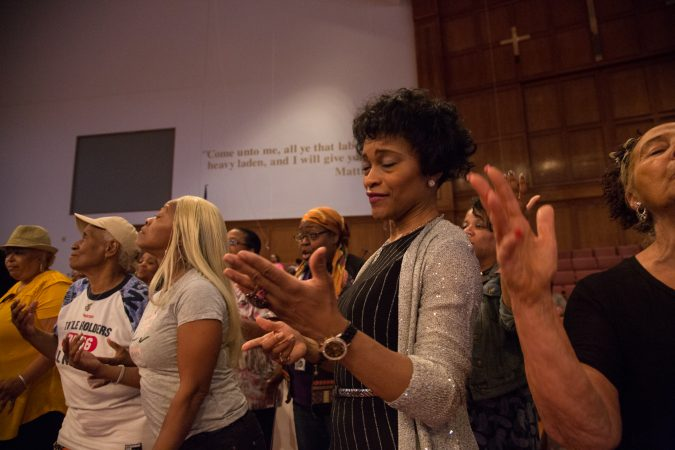 Monica Keitt, from Enon Tabernacle Baptist Church, rehearses with more than 100 faith singers and performers from across Philadelphia at Deliverance Evangelical Church in North Philadelphia on June 25 for their gospel concert at Independence Hall as part of this year's Wawa Welcome America celebration. (Emily Cohen for WHYY)