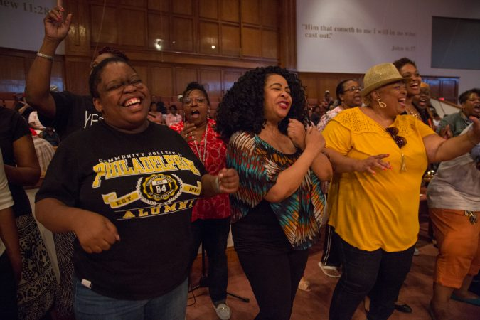 More than 100 faith singers and performers from across Philadelphia gather at Deliverance Evangelical Church in North Philadelphia on June 25 to rehearse for their gospel concert at Independence Hall as part of this year's Wawa Welcome America celebration. (Emily Cohen for WHYY)