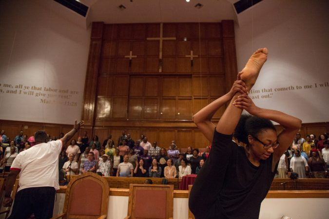 A Praise Dancer, from Mother Bethel African Methodist Church in South Philadelphia, dances to the music of the multi-community choir that gathered at Deliverance Evangelical Church in North Philadelphia on June 25 to rehearse before their gospel concert at Independence Hall as part of this year's Wawa Welcome America celebration. (Emily Cohen for WHYY)