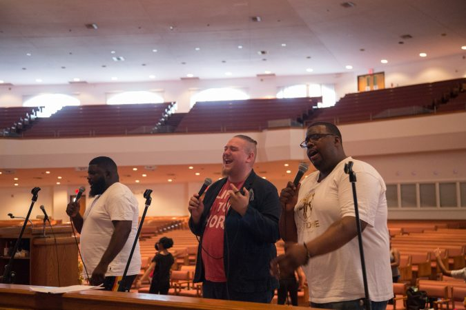 From left, Minister Edward Fields, Minister Justin Gonzalez, and Rev. Alyn E. Waller rehearse at Deliverance Evangelical Church in North Philadelphia on June 25 for their gospel concert at Independence Hall as part of this year's Wawa Welcome America celebration. (Emily Cohen for WHYY)
