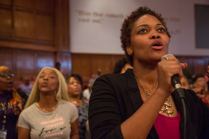 Maria Caldwell, from Pentecostal Experience, sings in a duet with members of a multi-community choir sing her chorus. More than 100 faith singers from across Philadelphia gather at Deliverance Evangelical Church in North Philadelphia on June 25 to rehearse for their gospel concert at Independence Hall as part of this year's Wawa Welcome America celebration. (Emily Cohen for WHYY)