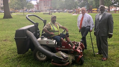 Scott Wagner in Malcolm X Park post-cleanup, accompanied by a contractor, supporter and lawnmower. (Photo by Wagner Campaign)