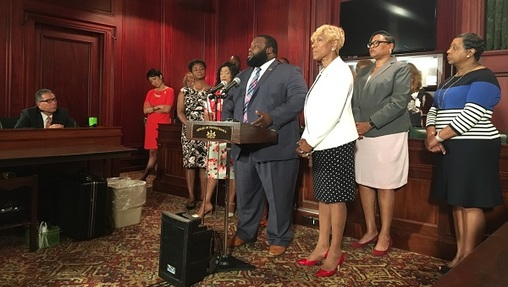 Representatives Jordan Harris and Carol Hill-Evans stand with the Grandview Five — the name the women involved in the golf course incident have given themselves. Jordan said he is