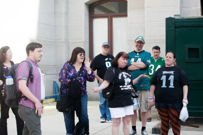 Eagles fans sing the team's fight song at a rally for the team at City Hall Tuesday evening a day after President Trump canceled an event at the White House to honor the Super Bowl Champions. (Brad Larrison for WHYY)