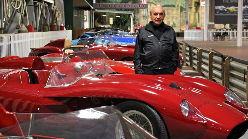 Dr. Fred Simeone stands amid his collection at the Simeone Foundation Automotive Museum, which traces the history of auto racing and emphasizes the value of competition as a spur to progress. (Emma Lee/WHYY)