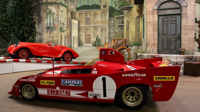 Alfa Romeo racers from 1937 and 1975 share the stage that evokes the streets of central Italy, where the Mille Miglia road race was held. (Emma Lee/WHYY)