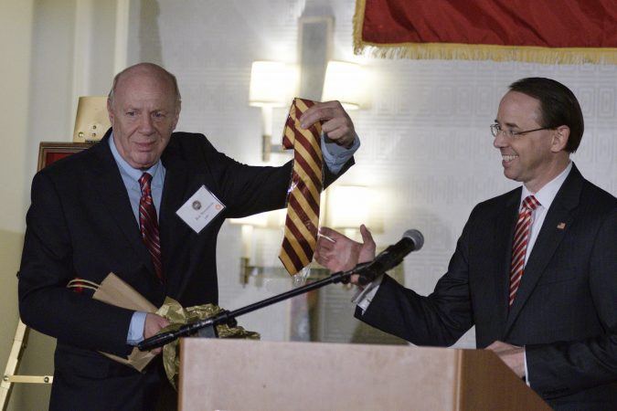 Deputy Attorney General Rod Rosenstein receives a crimson-yellow tie from his father, Central High alumni Robert Rosensten, during the annual alumni dinner at Central High School, Tuesday evening in Phildelphia. (Bastiaan Slabbers for WHYY)
