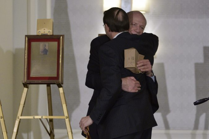 Deputy Attorney General Rod Rosenstein hugs his father, Central High School alumni Robert Rosensten, during the annual alumni dinner Tuesday evening in Philadelphia. (Bastiaan Slabbers for WHYY)
