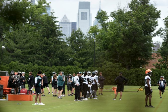 With Center City skyline seen as backdrop the Philadelphia Eagles practice at the NovaCare Complex in South Philadelphia a day after the canceled invite to the Super Bowl Championship celebration at the White House. (Bastiaan Slabbers for WHYY)