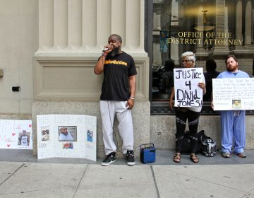 Isaac Gardner (left), of the Justice for David Jones Coalition, leads a small protest outside the district attorney's office calling for charges against Ryan Pownall, the Philadelphia police officer who fatally shot Jones during a traffic stop.