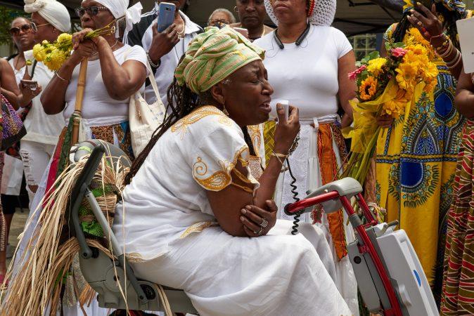 Iya Olakunle Sangofemi Oludina sings into a megaphone at the Odunde Festival in Philadelphia on Sunday, June 10, 2018. (Natalie Piserchio for WHYY News)