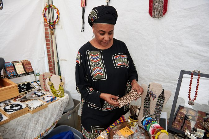 Rashida Watson, owner of the Silk Tent, has been coming to the Odunde Festival since the late 1970s. The Silk Tent offers textiles, jewelry, and African artifacts. (Natalie Piserchio for WHYY News)