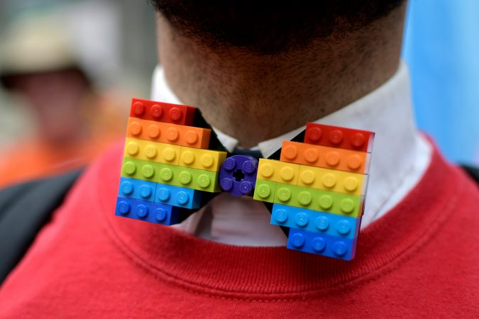 Micheal Assetto, of Ardmore, Pa., dons a homemade rainbow Lego tie as he participates with the Target delegation, during Philadelphia's 30th annual PrideDay parade on Sunday, June 10, 2018. (Bastiaan Slabbers for WHYY)