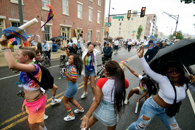 Near the end of the Philadelphia pride parade route, a large group of people gathers to counter-protest a man and his following on Sunday, June 10, 2018. (Bastiaan Slabbers for WHYY)