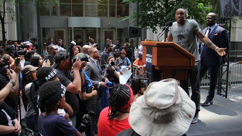 Activist Marc Lamont Hill speaks at a rally for Meek Mill outside the Criminal Justice Center. (Emma Lee/WHYY)