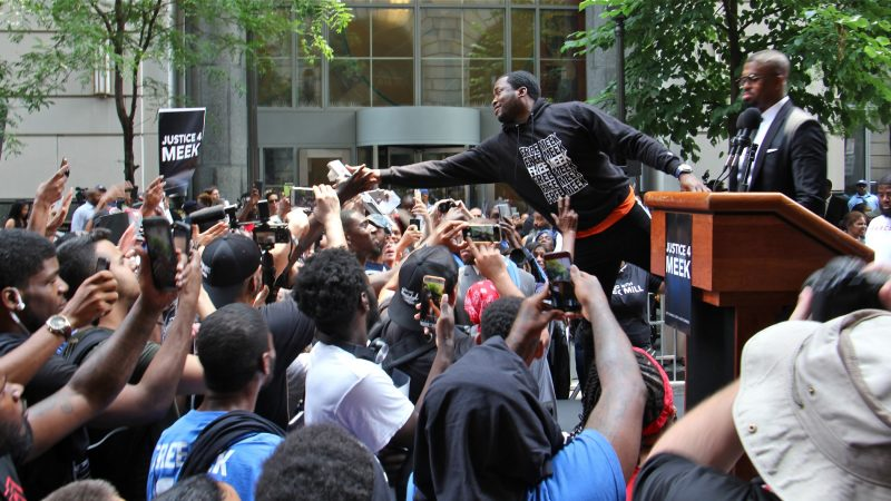 Meek Mill reaches out to supporters outside the Criminal Justice Center before his hearing to ask for a new trial on 10-year-old gun and drug charges. (Emma Lee/WHYY)