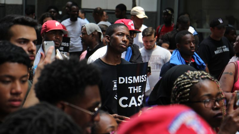 Protesters fill Filbert Street outside  the Criminal Justice Center during a rally for for Meek Mill, who was seeking a new trial on 10-year-old drug and gun charges. (Emma Lee/WHYY)