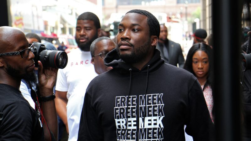Rapper Meek Mill arrives at the Juanita Kidd Stout Center for Criminal Justice for a hearing. Hundreds of supporters filled the street outside the courthouse. (Emma Lee/WHYY)