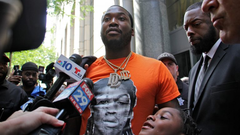 Meek Mill leaves the Criminal Justice Center with his attorneys after asking a judge to throw out a 10-year-old conviction on gun and drug charges. (Emma Lee/WHYY)