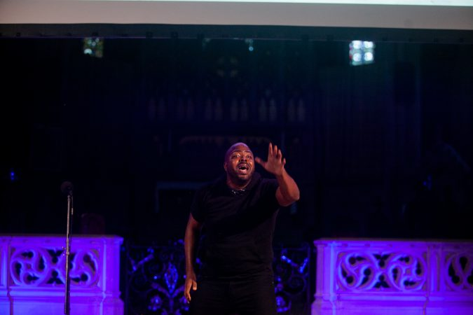 Khalil A.M.R Munir, a singer, dancer and instructor performs at Finding Sanctuary at Church of the Advocate in North Philadelphia. (Brad Larrison for WHYY)