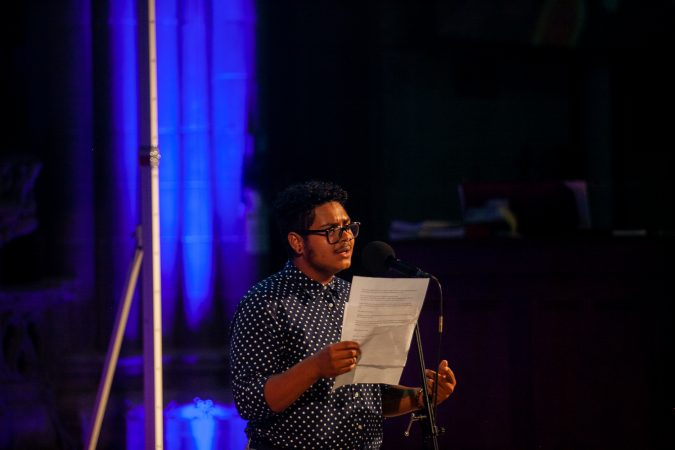 Corem Coreano, a multidisciplinary artist, shares a story at Finding Sannctuary at Church of the Advocate in North Philadelphia. (Brad Larrison for WHYY)