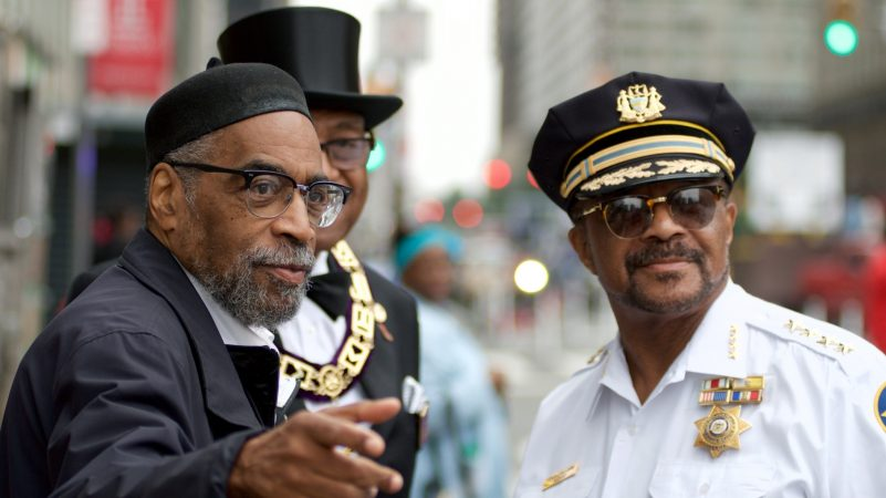 Kenneth Gamble and Sheriff Jewell Williams converse ahead of the annual Juneteenth parade through Center City. (Bastiaan Slabbers for WHYY)
